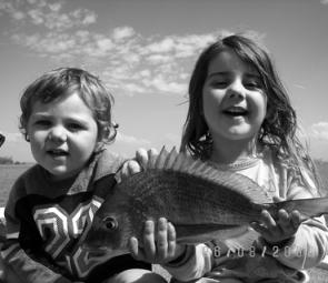 Chloe and Natt holding a nice bream.