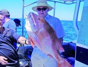 This visitor from Finland was taken by surprise when this great reddie jumped on his line.