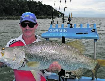 Dave with a nice 92cm barramundi caught on a shallow diver.