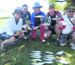 From left, Terrie Chin, Giancalo, Lesley, Andrew, Leo and Alex with whiting, bream, flathead and dart bagged during a successful beach session.