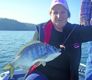 Heather with a well conditioned bream caught on a lure.