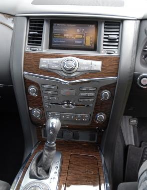 Woodgrain trim, brushed metal highlights plus prominent dials characterise the Y62 Patrol's dash layout.