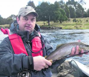 The author with a Whitewater brown, taken on a large black bead head Fuzzle Bugger.