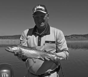 Peter Schroeder with a 2kg brown trout caught trolling Lake Eucumbene at Cemetery Point with a Lofty's Eucumbene Special