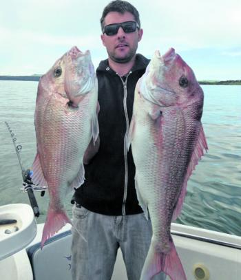 Simon Murnane with a couple of snapper caught in 5m of water north of Corinella. While fishing the incoming tide with yakka and squid, Simon and his brother caught five solid fish and released a few fish as well.