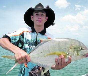 Axel Polmear with a golden trevally from the Embley River.