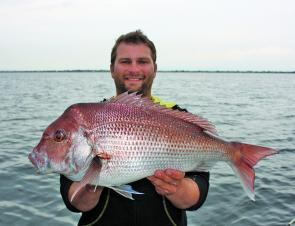 Andrew Clark with one of the awesome snapper being caught in the bay in recent times.