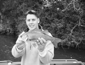Brandon Heagney from Tackle World Southport with a nice bass caught on a deep-diving Jackall Chubby .