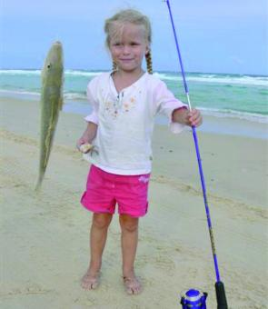 Jayde Lacey caught a 530g whiting on Teewah Beach with her favourite Scooby Doo rod.