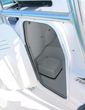 The craft's marine toilet is accessed via a door to starboard.