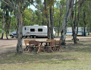 Tables and chairs are provided for camper's enjoyment and are a lovely place to relax.