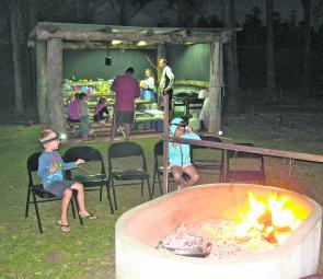 The camp fire is set apart from the camp kitchen and provides an ideal place to put on a camp roast in the camp ovens.