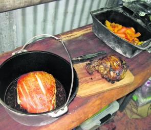 The results of a camp oven cook up – roast pork, roast lamb and a stack of roast vegies. Dinner anyone?