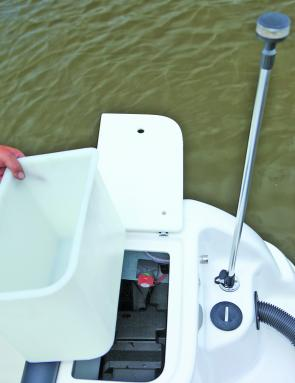 The lift-out bin in the transom cap gives top access to systems below, including battery switch, fuel breather and fuel filler.
