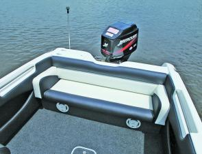 The rear lounge features luxurious armrests and the speakers for the marine stereo.