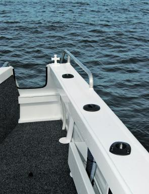 The step-through transom is very handy and there are plenty of rod holders in the gunwales, side rails for extra hand holds and bollards. Side pockets provide extra storage.