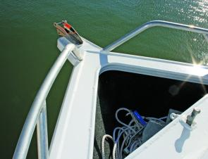 The short foredeck is dominated by a cavernous, carpeted anchor well/