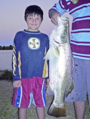 Eight-year-old Zane Rynswoud caught his first and biggest barra recently, with the help of his dad, Mick.