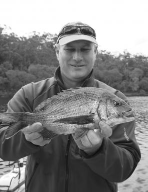 Macka with a stud black bream well over a kilo from one of the far southern estuaries.