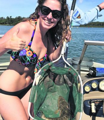 Kirsty Holmes was happy with her dusky flathead that was caught while on holidays at Forster.