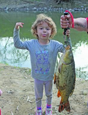Skye Alexander with a monster fat European carp caught in the Ovens River in Wangaratta on a bunch of tiger worms.