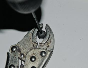 Using a pair of pliers or multigrips to hold your sinker, drill through it with the 3mm bit. Do this in several tries, removing the bit several times to clean it as you drill through. I have used a no. 2 ball sinker here, but you may want to test the floa