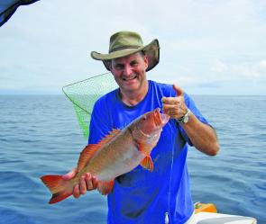 Bill Page from PNG with a typical Cairns caught coral trout.