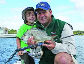 The author and son Sam enjoy some quality time on the water. Take your kids fishing this month and give Mum some quiet time.