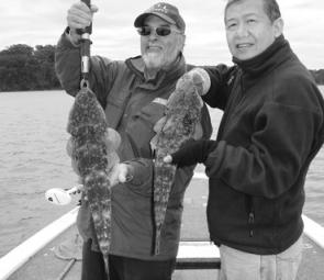 Alfie and Sui-Ming from Canberra with a couple of quality flathead from Narooma's Wagonga Inlet.