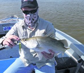 Clayton Nicholls with a decent barra taken on a Sebile Stick Shad while stickbaiting across the flats.