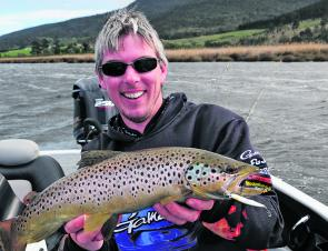 Leigh McKenzie of Bream and Trout Fishing Tasmania with another very good Derwent trout.