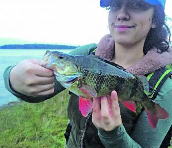 Eden Barlow with one of many nice redfin she has caught recently.