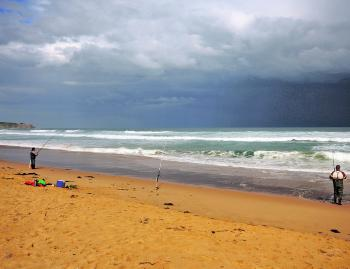 Winter storms may brew over Bass Strait, but that doesn't deter the salmon from biting at Cape Woolamai.