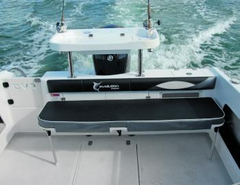 One handy thing about the Evolution 552 is the ease in which the rear seat can be dropped to enlarge the fishing area. This boat also gives users the protection of a cuddy cab with bunks, and it has excellent fuel capacity and a range of other desirable a
