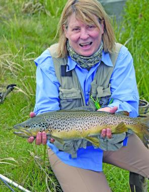 Brown and rainbow trout abound around Twizel. Denise Kampe took this brown trout on a size 16 Adams dry fly.