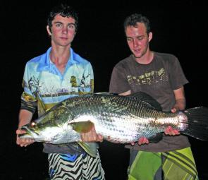 Geordie McBride and Kerrin Taylor with a 113cm impoundment barramundi caught on a 130mm Slick Rig light.