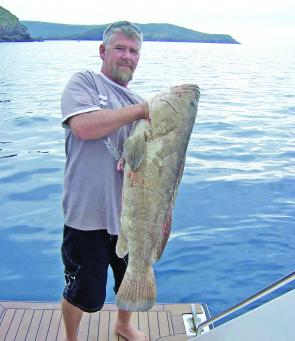 Billy holds up a good-sized cod, many of which can be found around Keppel Island's many reefs.