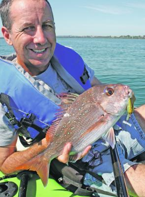 Small snapper like this one caught by Dennis Klau are still readily available during the warmer months.