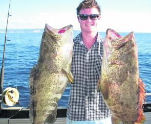 Alex from Gympie with two excellent gold spot cod caught at Rainbow Beach.