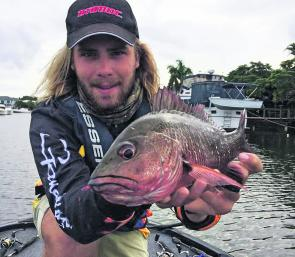 Zac Skyring fishing one of the many Gold Coast canals to pull this nice little jack on an Atomic Bream Shad.