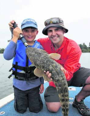 Riley, 8 and dad Tim with a 75cm flattie from Tuross Lake that fell to an 80mm Squidgy Wriggler. The fish was released in super condition.