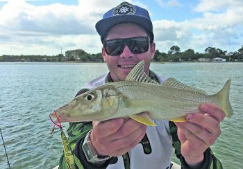 Jordan Zerk with an elbow-slapping whiting, which he caught on a surface lure at the top of the Frying Pan.
