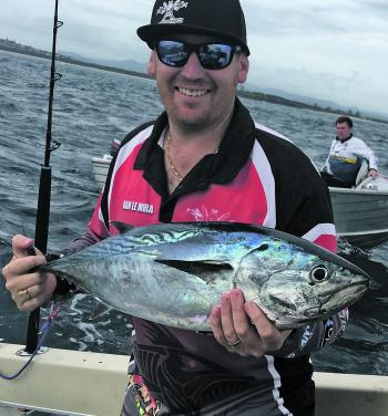 Dan Le Mura with a barrel of a mac tuna caught at South Reef.