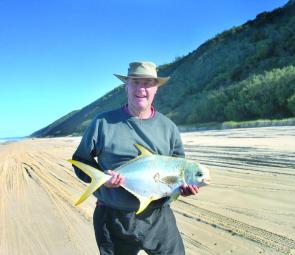 Andrew Faulkner with a snub-nosed dart caught at Teewah Beach. The best baits to target snubbies are pipis or worms.