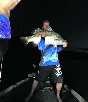Mark with a heavy looking night barra.