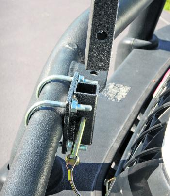 LEGAL: Some rod holders, such as this one are designed to be easily removed. The locking pin is removed and the stem of the rod holder is slid out of the bracket and then stored away. All that is left is the mounting bracket, which is behind the fr