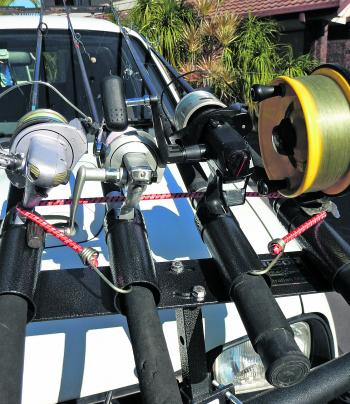 Your rods also need to be secured so there is no chance that they come dislodged during transit or if you were to brake suddenly. A stretchable strap can secure them into the rod holder and/or the tips secured to a carriage bar or other point on the roof