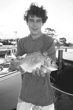 Max Gordon-Hall with a neat bream from the Greenwell Point wharf.