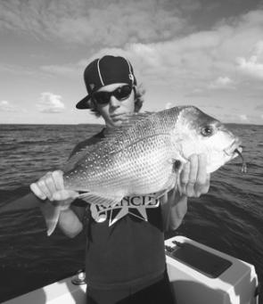 Bradley Carnelutti with a 2kg Jervis Bay snapper which ate a pink Squidgy head rigged with a green Saltwater Assassin tail.