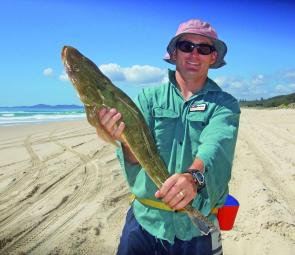 Lyle Gothmann of Blackwater caught this 62cm flathead on a beach fishing trip with Chizo of Noosa Surf Fishing Tours.